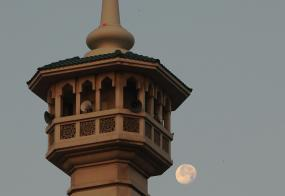 Full moon over Dubai, mosque tower